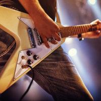 Metal guitarist playing a v neck