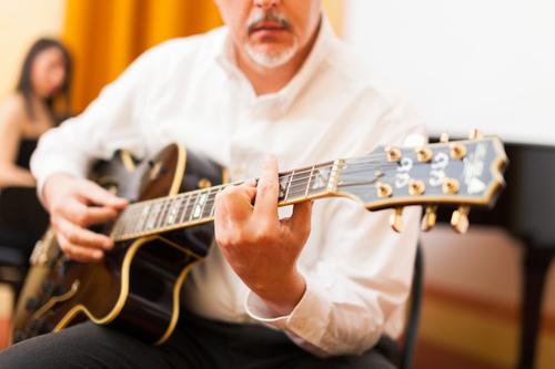 Gentleman playing jazz guitar