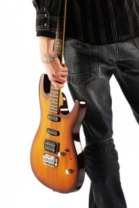 Man holding an electric guitar