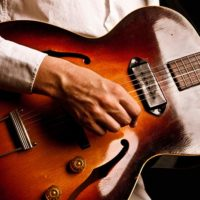 Jazz guitarist with a hollow body jazz guitar