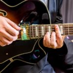 Guitarist playing in a jazz band