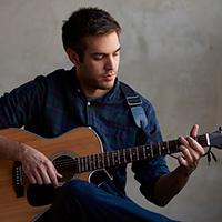 Advanced acoustic guitarist