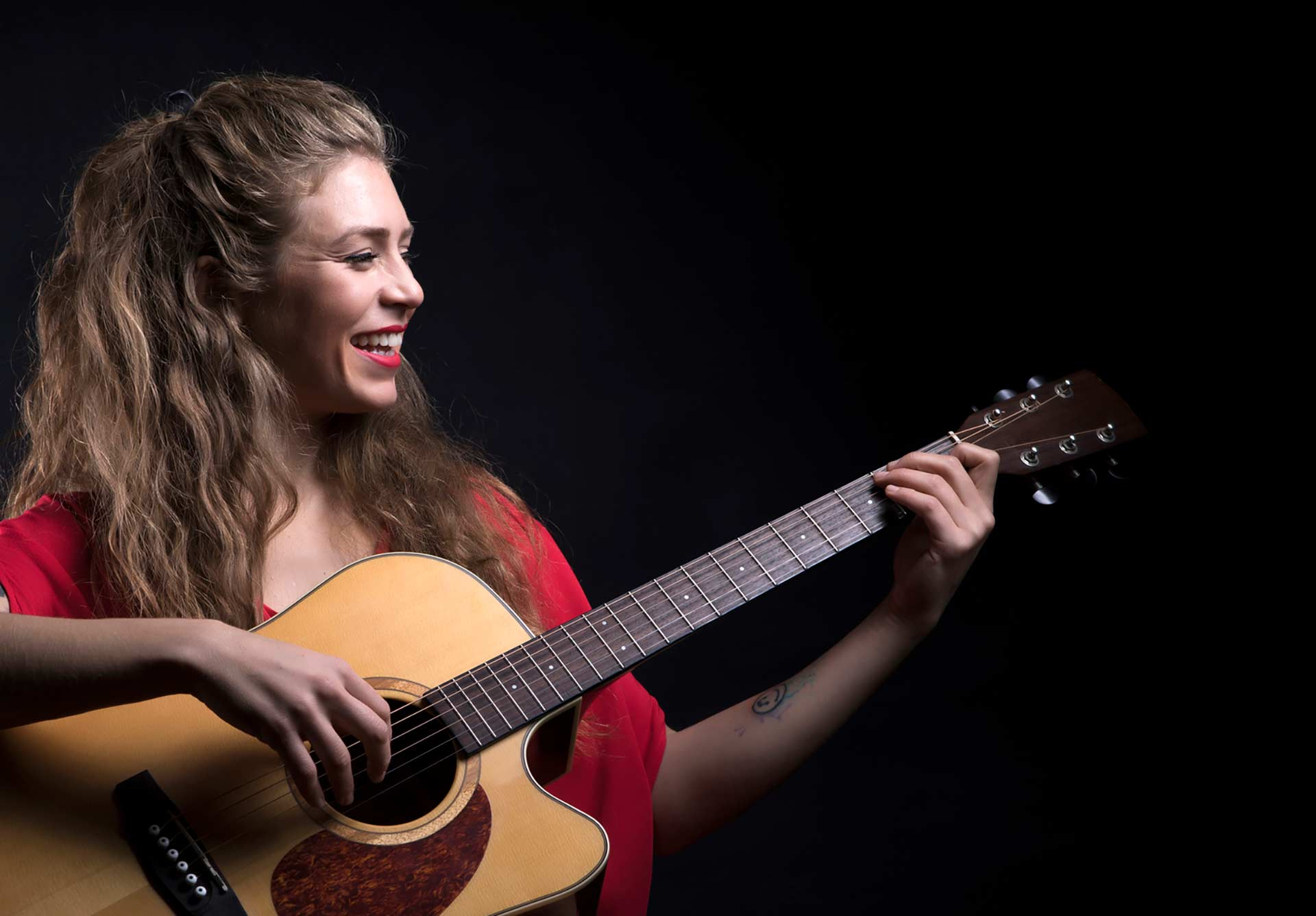 Beautiful lady playing the guitar