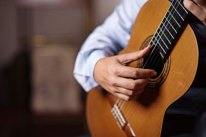 Classical guitarist practicing