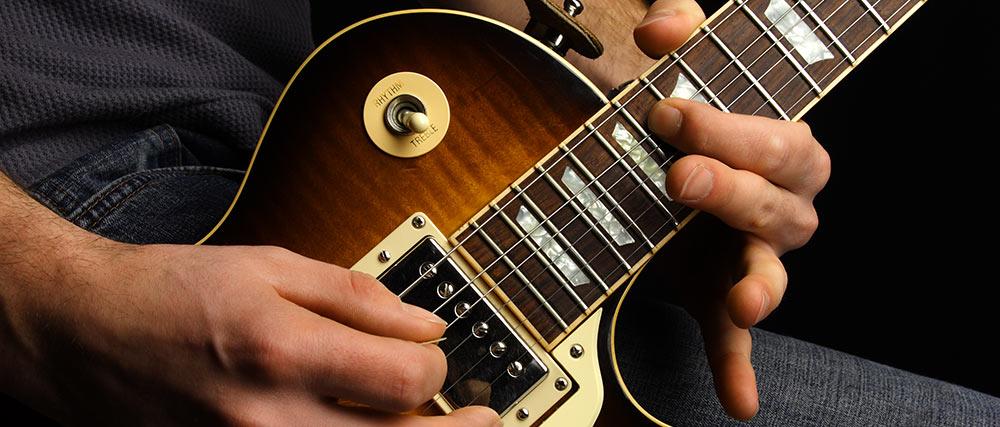 Electric guitarist close up