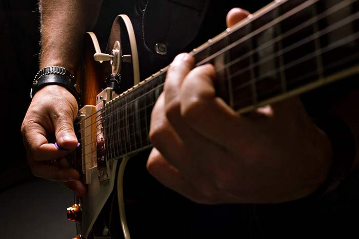 Electric guitarist playing a Gibson