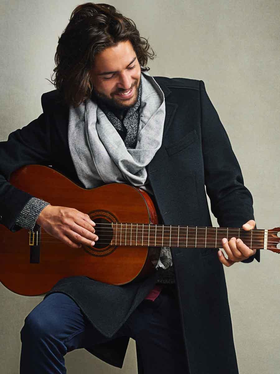 Gentleman playing guitar