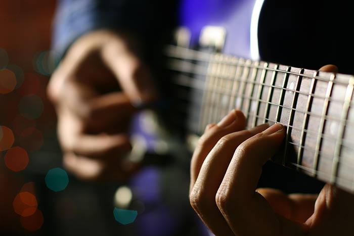 Guitarist playing a pentatonic scale