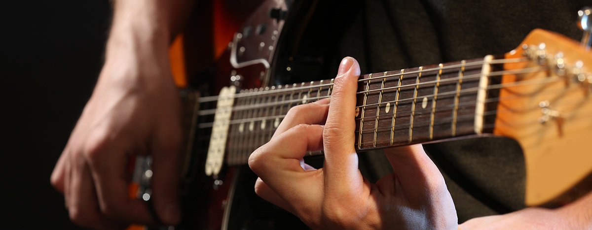 Hands on electric guitar