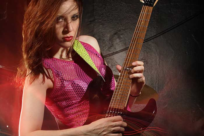 Woman playing an electric guitar solo