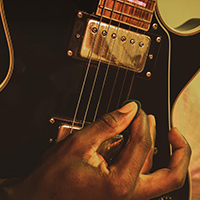 Man playing blues guitar