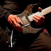 Man playing metal guitar