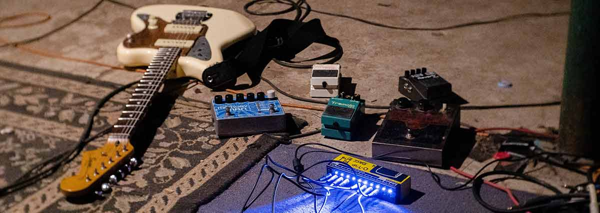 electric guitar and pedals on the floor