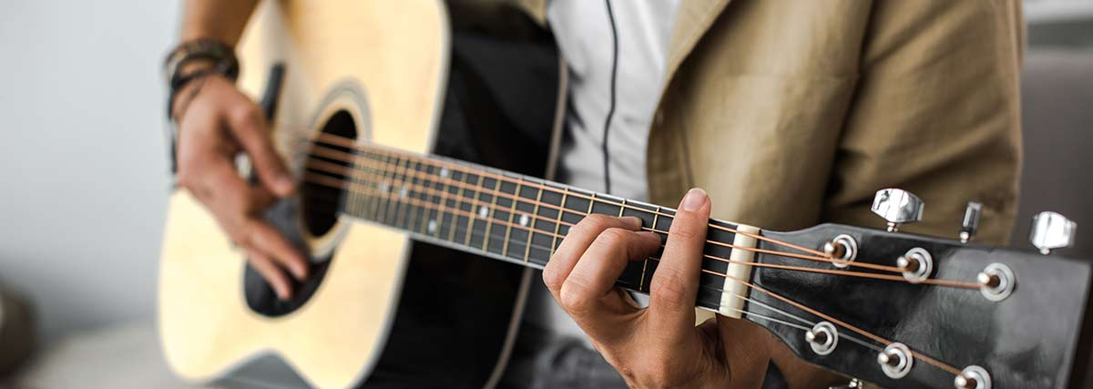 man-playing-the-acoustic-guitar