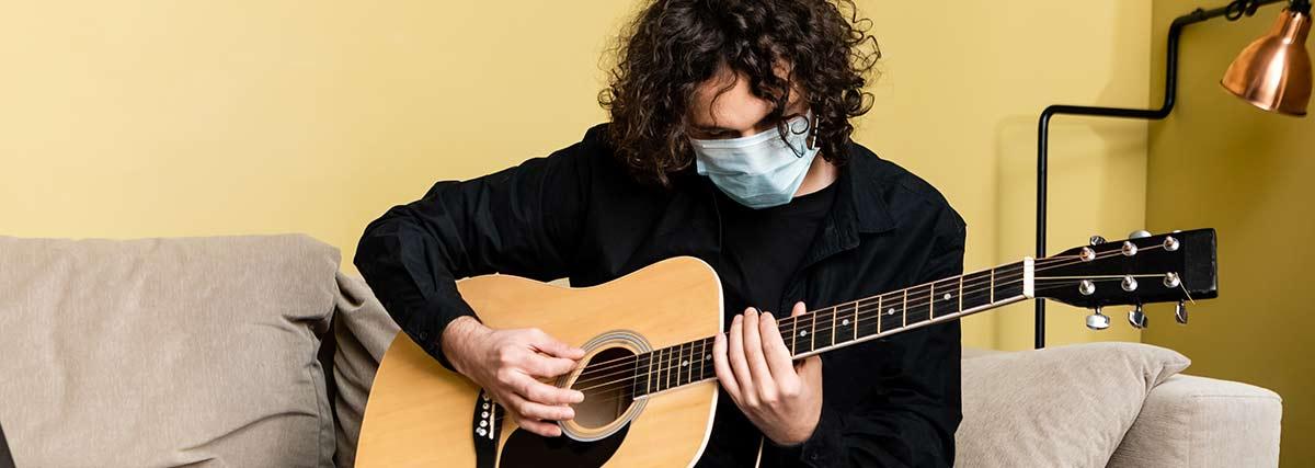 man-practicing-the-guitar