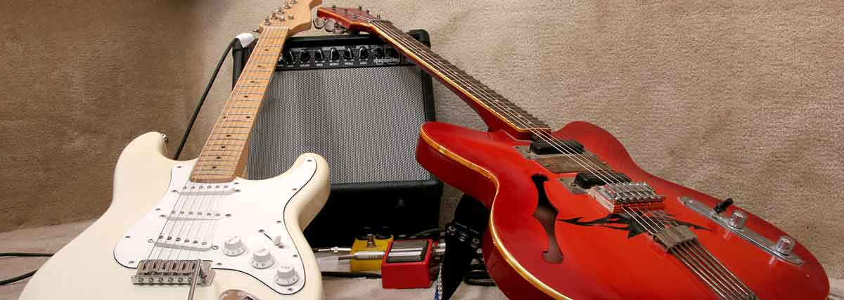 two-guitars-leaning-on-the-amplifier