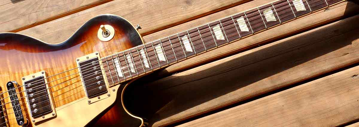 jazz guitar on wooden surface