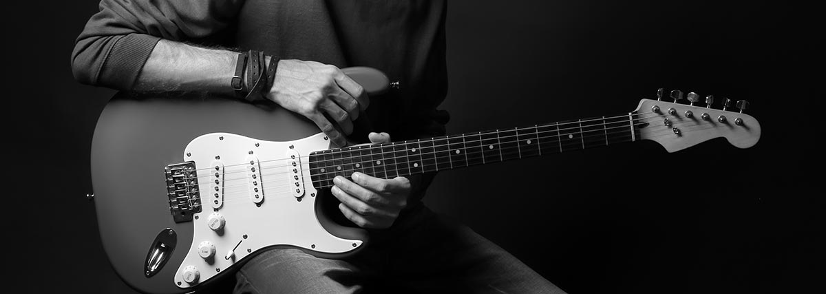 man holding his guitar