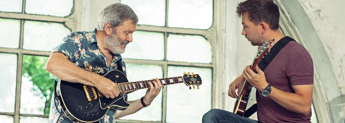 two guitarist playing
