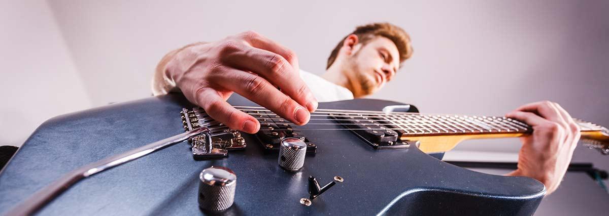 man performing the guitar